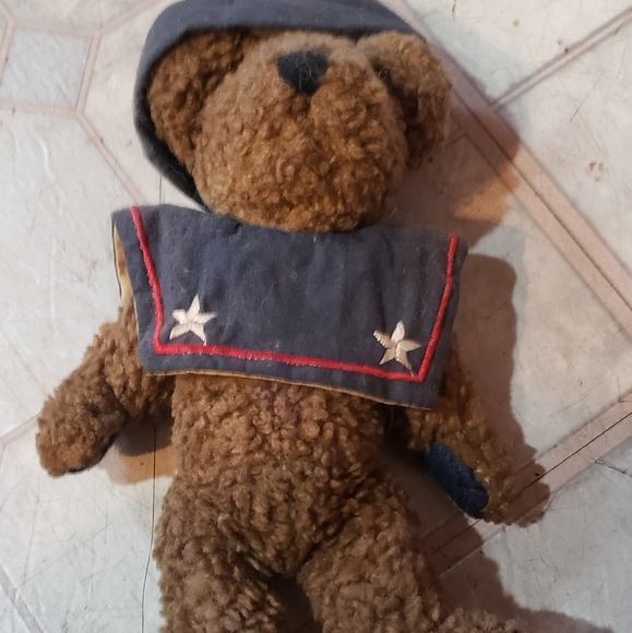 Small jointed boyd bear with hat